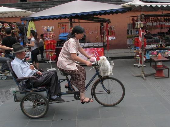 נהג ריקשה בצ'נג�ו סין